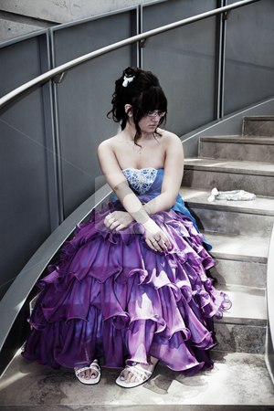 Dateless on Prom Night stock photo, A young girl sits alone in her prom dress on a lonely flight of stairs. by Brenda Carson