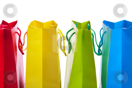 Bright Colored Shopping Bags stock photo, Closeup of four brightly colored shopping bags.  Shot on white background. by Brenda Carson