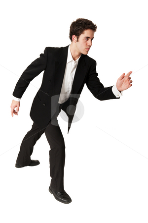 Determined Young Businessman stock photo, A determined young businessman on the go. by Brenda Carson