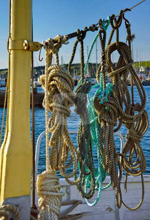 Ropes on Boat Deck stock photo, Neatly prepared ropes on a boat deck in Falmouth harbour Cornwall by Robert Ford