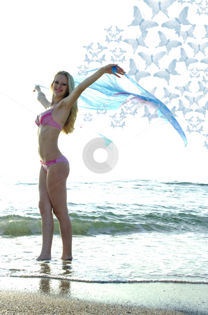 Butterfly stock photo, The young butterfly flits over sea waves by Aleksandr GAvrilov