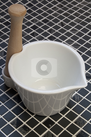 Mortar and pestle stock photo, A mortar and pestle. by Jeff Carson