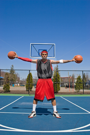 Confident Basketball Player stock photo, A young basketball player palming two basketballs. by Todd Arena