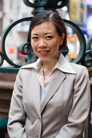Asian Business Woman stock photo, An Asian woman dressed in business attire in the city. by Todd Arena