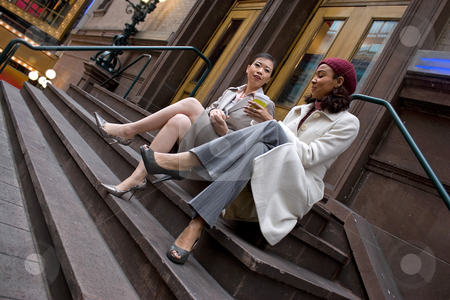 Business Women in the City stock photo, Two business women having a casual meeting or discussion in the city. by Todd Arena