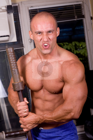Bodybuilder posing stock photo, Bodybuilder posing in the gym by Istv??n Cs??k
