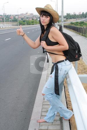 Posing girl in blue jeans  stock photo, Posing girl in blue jeans near roads by Sergii Mogyla