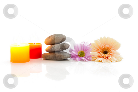 Flowers, candle, stones - spa theme stock photo, A spa theme still life with candle, river stones and flowers, isolated on white with reflections by Alexander Zschach