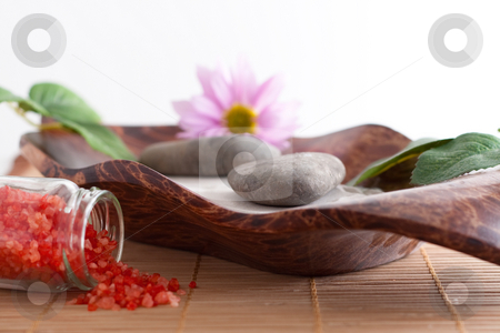 Bath salt, massage stones, bowl, purple flower and sand stock photo, Massage stones on sand in a bowl, a purple flower and red bath salt isolated on white background by Alexander Zschach