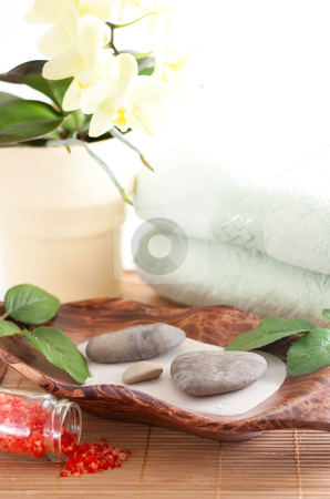 Orchied, massage stones, sand, and towels stock photo, Yellow orchid, massage stones, two towels isolated on white background by Alexander Zschach