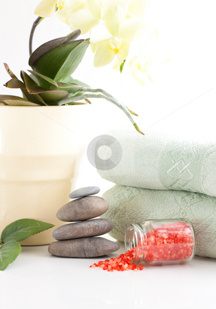 Orchied, massage stones and towels stock photo, Yellow orchid, massage stones, bath salt and two towels isolated on white background by Alexander Zschach