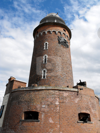 Lighthouse in Kolobrzeg stock photo, Old defence tower and lighthouse in Poland by Oxygen64