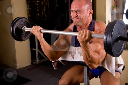 Bodybuilder training stock photo, Bodybuilder training his bicep by Istv??n Cs??k