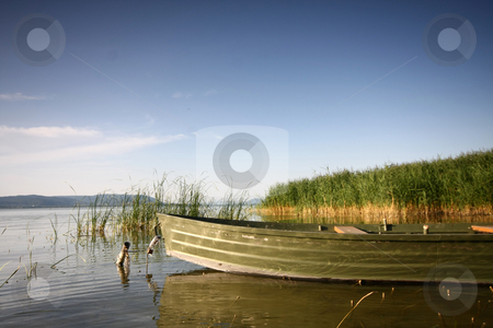 Lake with boat stock photo, Beautiful lake with boat by Istv??n Cs??k