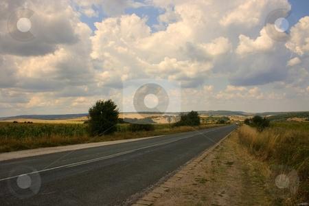Country road stock photo, Road in farmlad with cloudy sky by Minka Ruskova-Stefanova