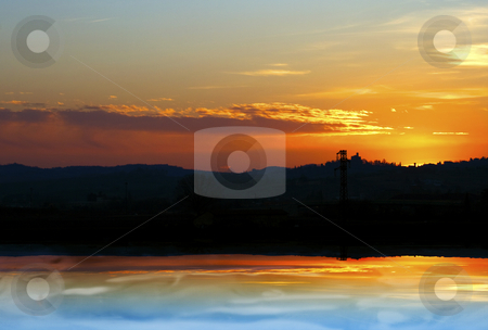 Sunset reflection stock photo, Beautiful sky and horizon reflection on water by Fabio Alcini