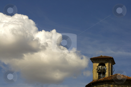 Cloud on church stock photo, A white cloud in the blue sky, over the belltower of a church by Fabio Alcini