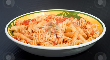 Mixed Pasta stock photo, A plate full of italian pasta of two kind (fusilli and penne) over a black background by Fabio Alcini