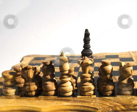 All vs. One stock photo, White army of chess fronting a lonely King by Fabio Alcini