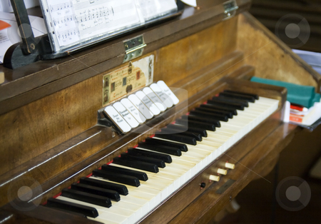 Church organ stock photo, Keyboard of an old church organ by Fabio Alcini