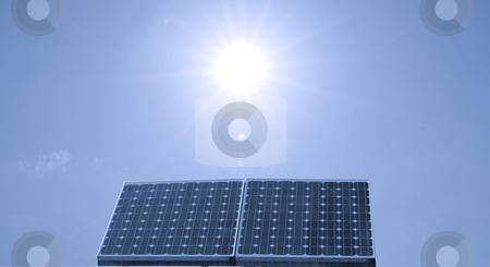 Solar panel stock photo, Closeup of a solar panel, blue sky by Fabio Alcini