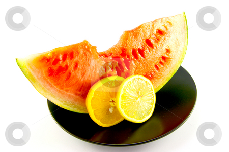 Watermelon with Slice of Lemon and Orange stock photo, Slice of red juicy watermelon with a slice of lemon and orange on a black plate with a white background by Keith Wilson