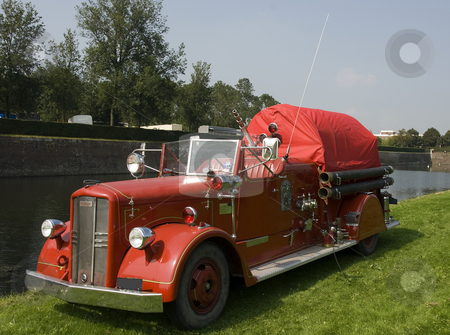 Fireman car stock photo, Very old firemann car in red with sirene and old lights by Chris Willemsen