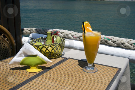 Tropical drink stock photo, Tropical drink on a terasse in greece placa matala by Chris Willemsen