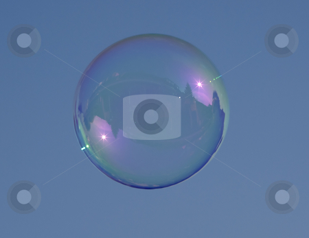 Water stock photo, Bubble blown from water and soap against a blue sky by Chris Willemsen