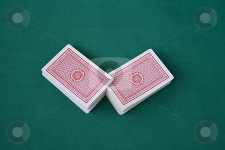 Play cards on green background stock photo, Play cards on green background by Minka Ruskova-Stefanova