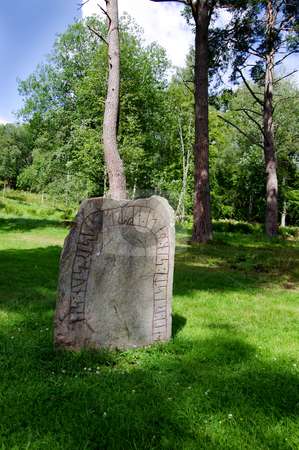Rune Stone stock photo, An ancient rune stone, strange rune letters, a summer day in Sweden. by Peter Soderstrom