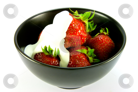 Strawberries and Cream stock photo, Whole red ripe strawberries with cream in a black bowl on a white background by Keith Wilson