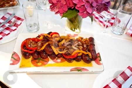 Grilled kielbasa stock photo, Grilled kielbasa with batter fried bell pepper rings. by Mariusz Jurgielewicz