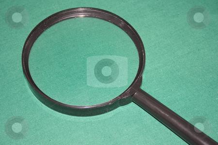 Magnifying glass stock photo, Magnifying glass on green background by Minka Ruskova-Stefanova