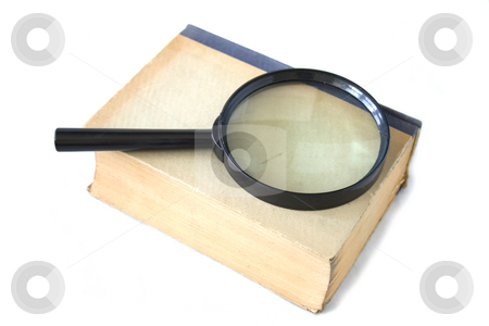 Ld book and magnifying glass stock photo, Old book and magnifying glass on background by Minka Ruskova-Stefanova
