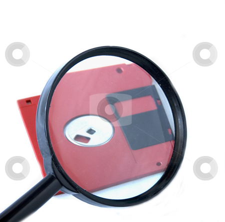 Magnifying glass and micro disk stock photo, Magnifying glass and red micro disk on white background by Minka Ruskova-Stefanova