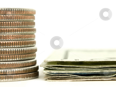 Macro of stacked money stock photo, Macro of stacked coins and cash on a white background by John Teeter
