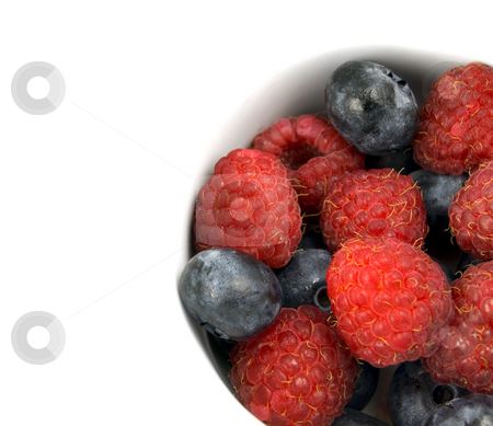 Close up raspberries and blueberries stock photo, Close up raspberries and blue berries with copy space by John Teeter