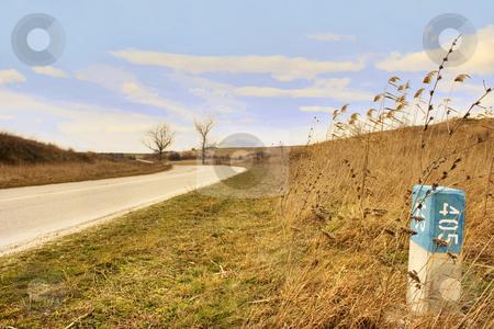 Milestone near road stock photo, Milestone near road by Minka Ruskova-Stefanova