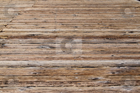 Boardwalk stock photo, Close up of an wooden brown boardwalk by Henrik Lehnerer