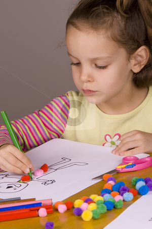 Girl drawing stock photo, Little Girl Drawing a picture of a the ginger bread man by Jandrie Lombard