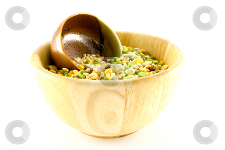 Soup Pulses stock photo, Assorted soup pulses in a small wooden bowl with other small green and brown bowl on a white background by Keith Wilson