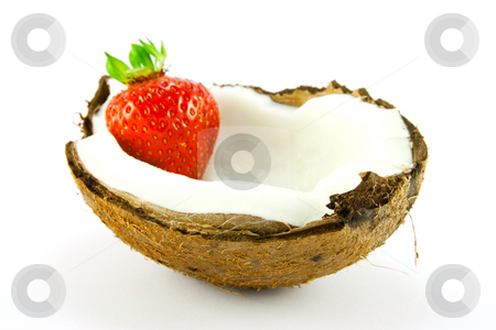 Strawberry in a Coconut stock photo, Single red strawberry in half a coconut with a white background by Keith Wilson
