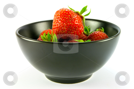 Strawberries stock photo, Whole red ripe strawberries in a black bowl on a white background by Keith Wilson