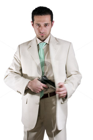 Man pulling out his gun stock photo, Isolated Mafia man pulling out his gun by Mehmet Dilsiz