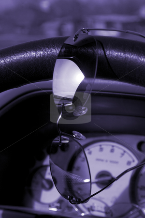 Sunglasses on the steering wheel stock photo, Reflection on the sunglasses on the steering wheel by Mehmet Dilsiz