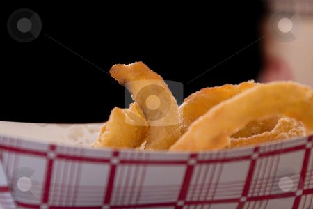 Close up on Onion Rings stock photo, Close up shot of Onion Rings by Mehmet Dilsiz