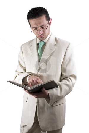 Businessman with a pair of glassed reading a book stock photo, Isolated businessman with a pair of glassed reading a book by Mehmet Dilsiz