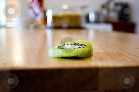 Sliced Kiwi on the Kitchen Table stock photo, Close up on a sliced kiwi on the kitchen table by Mehmet Dilsiz