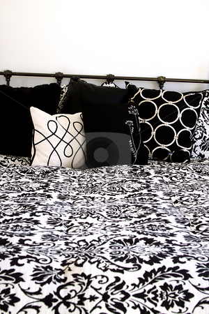 Close up on a bed  stock photo, Close up on the bed in a bedroom by Mehmet Dilsiz